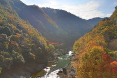 Arashiyama, Japan on the Katsura River during the autumn season Royalty Free Stock Photo