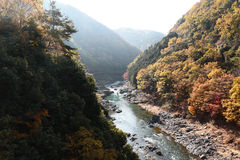 Arashiyama, Japan on the Katsura River during the autumn season. An Arashiyama, Japan on the Katsura River during the autumn season Stock Photos