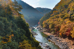 Arashiyama, Japan on the Katsura River during the autumn season. An Arashiyama, Japan on the Katsura River during the autumn season Stock Photography