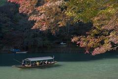 Arashiyama, Japan-27 Nov 2015: Group of Tourists cruising. In the River at Arashiyama on 27 Nov Royalty Free Stock Photo