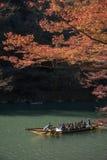 Arashiyama, Japan-27 Nov 2015: Group of Tourists cruising in the. River at Arashiyama on 27 Nov Stock Photos