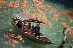 Arashiyama, Japan-27 Nov 2015: Group of Tourists cruising in the. River at Arashiyama on 27 Nov Royalty Free Stock Image