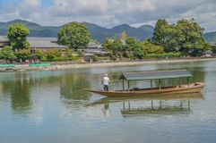 Arashiyama Katsura River Kyoto Japan. Tourist boat on the foreground Stock Photography
