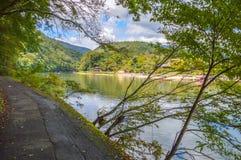 Arashiyama Katsura River Kyoto Japan. Tourist boats on the foreground Royalty Free Stock Image