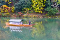 Arashiyama Kyoto Japan during autumn. Boat rowing on a rainy day at the Arashiyama area in Kyoto, Japan. Shot this on November 8th 2015 Stock Photo