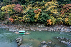 ARASHIYAMA, KYOTO. JAPAN. Japanese traditional tourism by boat in autumn season around the famous spot of Kyoto, Arashiyama. The great place for autumn in stock photography