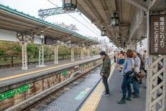Arashiyama railway station. Osaka, Japan - April 4, 2013:  Commuters waiting for a train for a train Arashiyama railway station on Hankyu Railway Kobe line. This Royalty Free Stock Photo