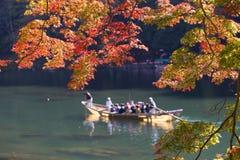 Arashiyama sightseeing. A sightseeing row boat with tourist travel in Katsura River, Kyoto, Japan Stock Photography
