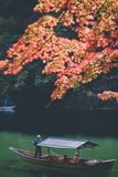 Arashiyama sightseeing. A sightseeing row boat with tourist travel in Katsura River, Kyoto, Japan Stock Images