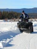 Aratro di neve di Atv Fotografie Stock