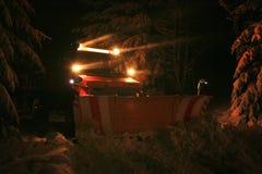 Aratro di neve di notte Immagini Stock