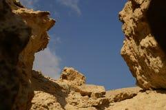 Arava desert. Hiking in Arava desert, Israel, stones and sky Royalty Free Stock Photography