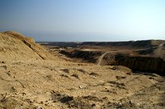 Arava desert - dead landscape, background. Hiking in Arava desert, Israel, stones and sky Royalty Free Stock Photos