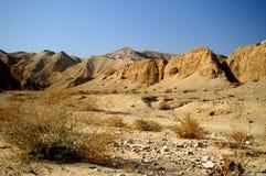 Arava desert - dead landscape, background. Hiking in Arava desert, Israel, stones and sky Royalty Free Stock Photography