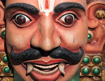 Aravan. Wooden sculpture of the head of Aravan, son of Arjuna before the start of the Mahbharata wars Royalty Free Stock Photo