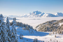 Aravis Mountain Range from Les Gets. Winter view from the slopes of Les Gets in the Portes du Soleil ski area, France. The distinctive peak of Pointe Percee in Royalty Free Stock Images