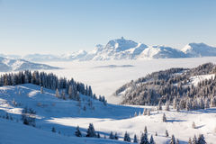 Aravis Mountain Range from Les Gets. Winter view from the slopes of Les Gets in the Portes du Soleil ski area, France. The distinctive peak of Pointe Percee in Stock Photography