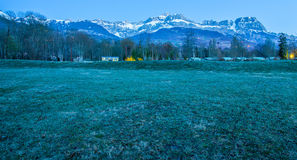 Aravis Range, France. View of Aravis mountain range with early sunlight from a grass field in Passy, France. Located in the Arve Valley, France, between Geneva Royalty Free Stock Photography