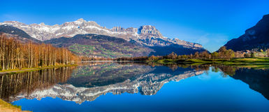 Aravis Range and Lac du Passy, France I. Panoramic view of Aravis mountain range reflected clearly on the surface of the surface of Lac du Passy, Passy, France Royalty Free Stock Photo
