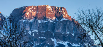Aravis Range Mountain Top, France II. View of a part of Aravis mountain range with early sunlight hitting the summit in Passy, France. Located in the Arve Valley Stock Photography