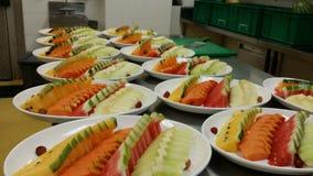 An aray of mixed fruits platter preparation. Mix fruits platter Royalty Free Stock Image