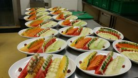 An aray of mixed fruits platter preparation. Mix fruits platter Stock Photos