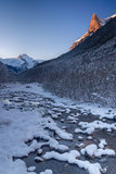 Arazas river snow covered at Ordesa National Park. View of Arazas river snow covered and sunset lights in the Tozal del Mallo mountain. Ordesa National Park Royalty Free Stock Photography