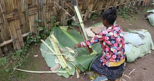 African woman of the Dorze ethnic group is preparing injera