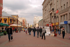 Arbat Street in Moscow,Russia. MOSCOW, RUSSIA - MAY 15, 2011: Locals and tourists walking on the famous pedestrian Arbat Street in Moscow,Russia. Street artists Stock Image