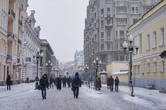 Arbat street in Moscow in winter. People walking by central Arbat street in Moscow in winter day Stock Photo
