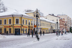 Arbat street in Moscow in winter. People walking by central Arbat street in Moscow in winter day Royalty Free Stock Images