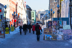 Arbat street of Moscow in wintertime. Popular pedestrian street - tourist attraction. Selling fine arts in Moscow. Everyday life of Moscow city in all the Stock Images