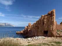 Arbatax with the known red porphyry rocks, Italy. Arbatax with the known red porphyry rocks nearby the port at the Capo Bellavista, Sardinia, Italy, Europe Stock Images