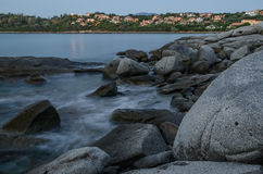 Arbatax town, Sardinia, Italy. Picture of rocky beach in Arbatax town taken by sunrise, Sardinia, Italy Stock Images