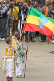 Arbegnoch Qen - Patriots' Day. Addis Ababa - May 5: A young boy dressed in colourful traditional outfit holds the Ethiopian flag at the 74th anniversary of Stock Photo