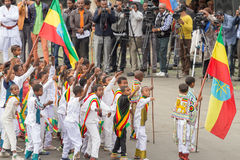 Arbegnoch Qen - Patriots' Day. Addis Ababa - May 5: Young children dressed in colourful traditional outfit perform in front of the Ethiopian President at the Royalty Free Stock Images