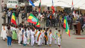 Arbegnoch Qen - Patriots' Day. Addis Ababa - May 5: Young children dressed in colourful traditional outfit perform in front of the Ethiopian President at the Stock Images
