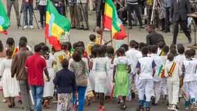 Arbegnoch Qen - Patriots' Day. Addis Ababa - May 5: Young children dressed in colourful traditional outfit perform in front of the Ethiopian President at the Royalty Free Stock Image