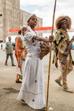 Arbegnoch Qen - Patriots' Day. Addis Ababa - May 5: A young girl dressed in colourful traditional outfit holding a spear and shield marches at the 74th Royalty Free Stock Images