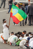 Arbegnoch Qen - Patriots' Day. Addis Ababa - May 5: A young girl dressed in colourful traditional outfit holds the Ethiopian flag at the 74th anniversary of Royalty Free Stock Photos