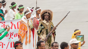 Arbegnoch Qen - Patriots' Day. Addis Ababa - May 5: Young men and women dressed in colourful traditional outfit march flag at the 74th anniversary of Patriots' Royalty Free Stock Photo