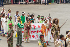 Arbegnoch Qen - Patriots' Day. Addis Ababa - May 5: Young men and women dressed in colourful traditional outfit march flag at the 74th anniversary of Patriots' Royalty Free Stock Photos