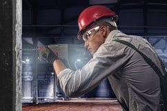 Arbeider bij een bouwwerf Stock Foto's