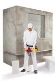 Arbeider die een isolatiekleefstof mengen Royalty-vrije Stock Afbeeldingen