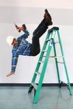 Arbeider die van een ladder vallen Royalty-vrije Stock Afbeelding