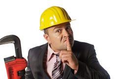 Arbeider in gele helm stock afbeeldingen