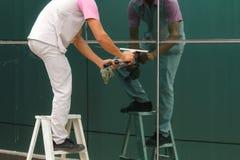 Arbeider het schoonmaken Stock Afbeeldingen