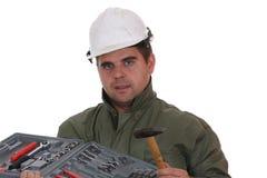 Arbeider met de hulpmiddelenreeks Stock Foto
