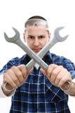 Arbeider met gekruiste moersleutels Stock Foto