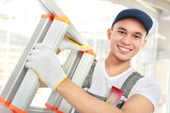 Arbeider met ladder Stock Foto's
